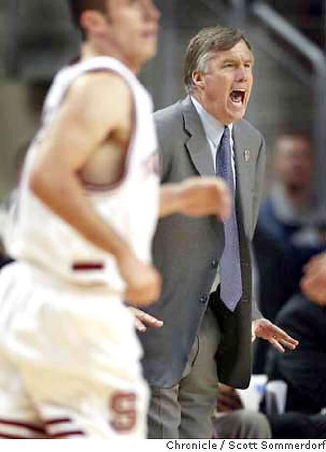 Despite Stanford's big leads during their win over UTSA, coach Mike Montgomery still was intense and did not let up on his players. This photo was in the late stages of the second half. Stanford defeats the University of Texas-San Antonio 71-45 during the first round of the Seattle NCAA regional, Thursday, March 18th, 2004.  Event on 3/18/04 in . / The Chronicle