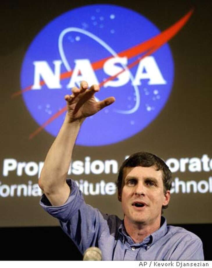 Steven Squyres, the main scientist for the Mars spirit rover mission, speaks to reporters during a briefing on the mission, Tuesday, Jan. 13, 2004, in Pasadena, Calif. (AP Photo/Kevork Djansezian) Photo: KEVORK DJANSEZIAN