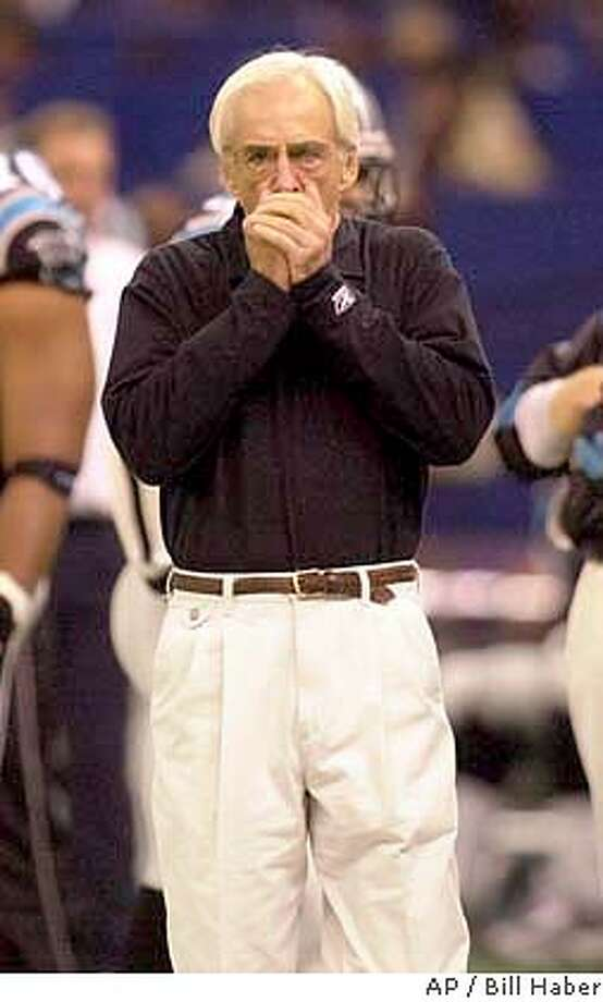 Carolina Panthers coach George Seifert blows on his hands as he walks the sidelines during their game against the New Orleans Saints, Sunday Dec. 2, 2001, in New Orleans. (AP Photo/Bill Haber) Photo: BILL HABER