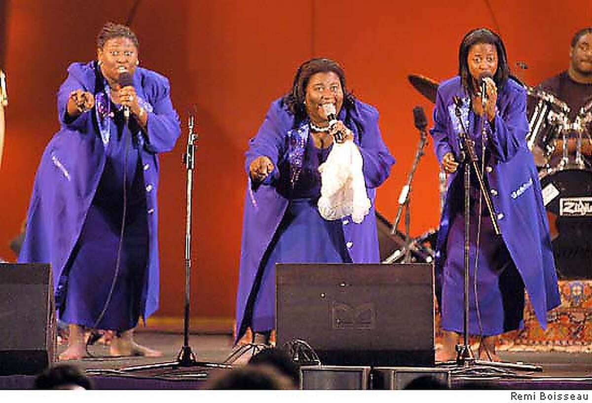 The annointed jackson sisters performing at the fes festival of world sacred music. The photo captures the architectural style of fes and the stage of the festival. Please credit Remi Boisseau