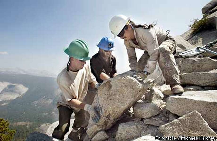 From left: Zebulen Marjanovich' Greg Torres and Emmanuel Esquivel move a chunk of granite into place on the steep slopes of Half Dome.  Trail restoration project on the Half Dome Trail in Yosemite National Park. Workers are repairing the switchback trails near the summit of Half Dome.  CHRONICLE PHOTO BY MICHAEL MALONEY Photo: MICHAEL MALONEY