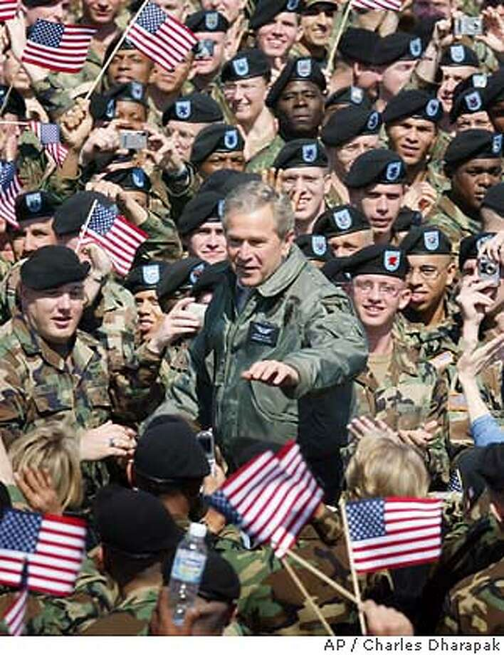 President Bush, center, arrives to speaks to troops from the 101st Airborne Division at Fort Campbell, Ky., Thursday, March 18, 2004.(AP Photo/Charles Dharapak) Photo: CHARLES DHARAPAK