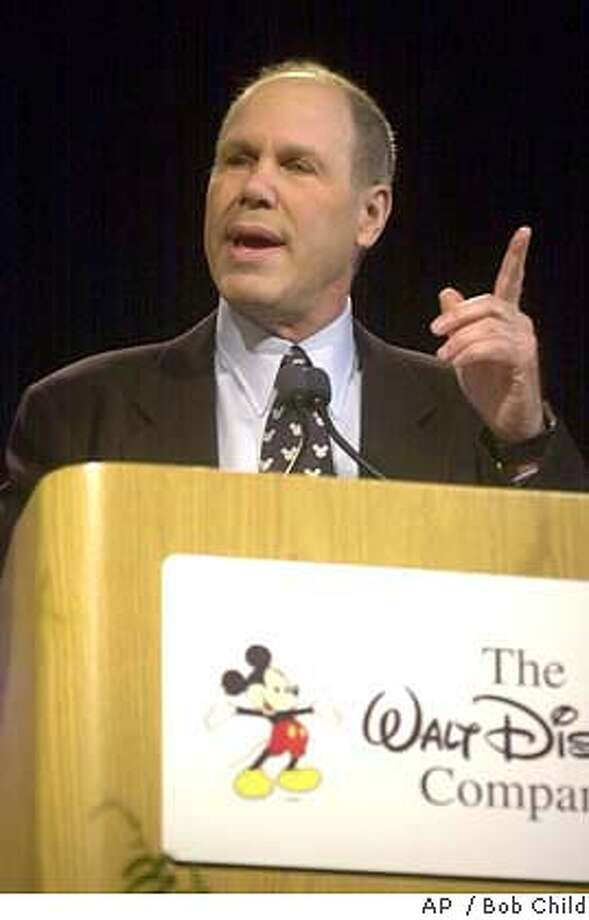 "** FILE ** The Walt Disney Co. chief executive Michael Eisner makes a point during his opening remarks Tuesday, Feb. 19, 2002, at the annual stockholders meeting in Hartford, Conn. Walt Disney Co. vice chairman Roy E. Disney stepped down from the board of directors and called on chairman and chief executive Michael Eisner to resign in a scathing letter. ""It is my sincere belief that it is you that should be leaving and not me,"" Disney wrote to Eisner. (AP Photo/BobChild) Walt Disney Co. CEO Michael Eisner is under fire from Roy Disney, nephew of Walt, and Stanley Gold, who resigned from the company's board of directors, saying Eisner's management style is the main factor in Disney's declining fortunes. DIGITAL IMAGE FEB. 19, 2002, FILE IMAGE Mickey Mouse's boss, Michael Eisner of Disney, is under fire. Photo: BOB CHILD"