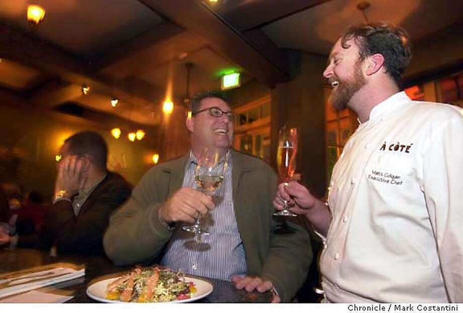 chefsnightout25_0015.JPG Photo taken on 1/14/04 in Oakland.  Chef Kimball Jones(left), dining at A Cote restaurant, has a drink with, jokes around with and talks shop with A Cote's executive cheff Matt Golgan(right).  CHRONICLE PHOTO BY MARK COSTANTINI MANDATORY CREDIT FOR PHOTOG AND SF CHRONICLE/ -MAGS OUT Photo: MARK COSTANTINI