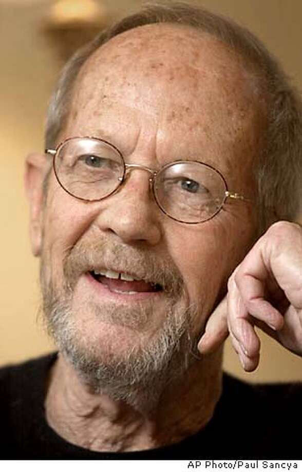 "ADVANCE FOR WEEKEND EDITIONS, FEB. 14-17--Elmore Leonard, who has spent half a century writing novels, screenplays and short stories, talks in his Bloomfield Village, Mich., home Dec. 11, 2001. At a time when many 76-year-olds might consider slowing down a bit, Leonard released his 37th novel, ""Tishomingo Blues"" on Jan. 29, 2002. It's part of a three-book deal he signed last summer with new publisher William Morrow. (AP Photo/Paul Sancya) CAT HFR 02-14-02. ADVANCE FOR WEEKEND EDITIONS, FEB. 14-17. DIGITAL CAMERA Photo: PAUL SANCYA"