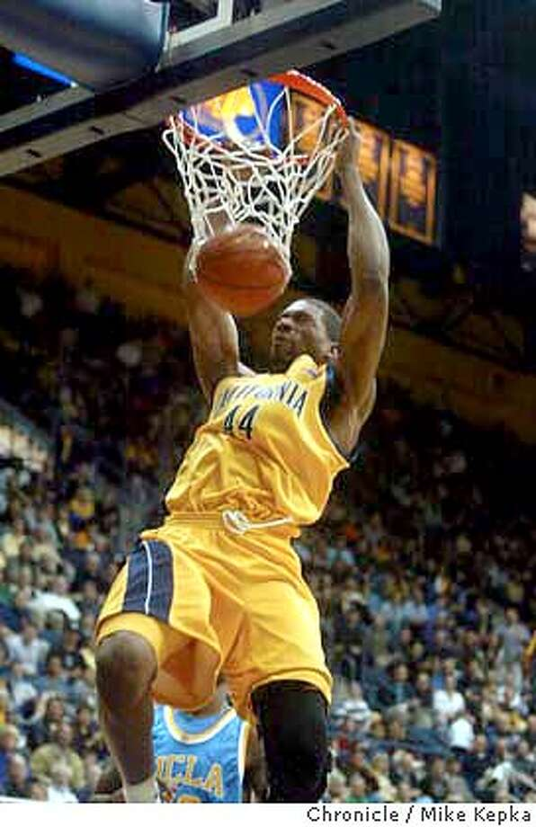 Bears Leon Powe takes a slam dunk near the end of first half.  Cal Golden Bears play against UCLA Bruins at Haas pavilion Saturday. MIKE KEPKA/The Chronicle Photo: MIKE KEPKA