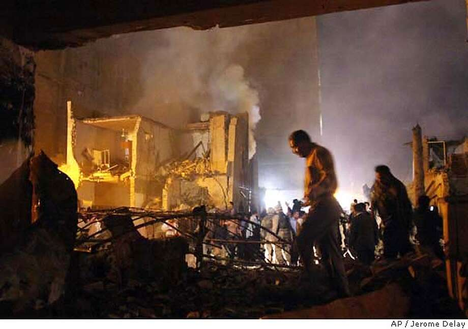 A huge car bomb destroyed a five-story hotel in central Baghdad, Wednesday night, killing at least 10 people, Iraqi police and U.S. soldiers said. American forces and Iraqi ambulances hurried to the scene to help. Rescuers could be seen pulling bodies from the rubble of the Hotel Jabal Lebanon, that was hit just three days before the first anniversary of the start of the U.S.-led war to topple Saddam Hussein. (AP Photo/Jerome Delay) Photo: JEROME DELAY