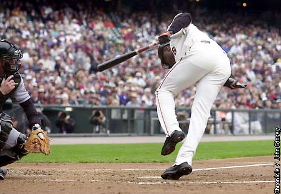 GIANTS23-C-22AUG02-SP-JRS-The Giants vs. the Mets at Pac Bell Park. Barry Bonds gets hit in the 1st inning. The catcher is Vance Wilson of the Mets. Chronicle Photo by John Storey. Photo: John Storey