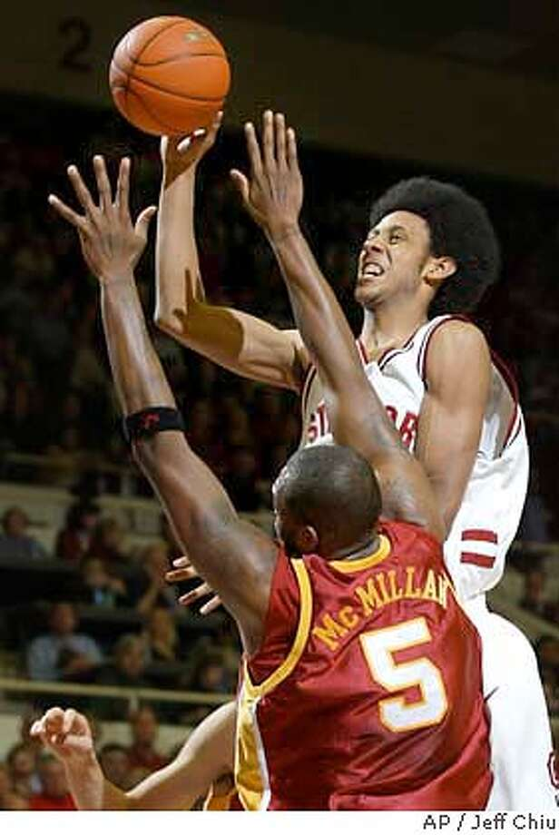 Stanford's Josh Childress attempts a shot as Southern California's Jeff McMillan defends in the first half on Saturday, Jan. 24, 2004 in Stanford, Calif. (AP Photo/Jeff Chiu) Photo: JEFF CHIU