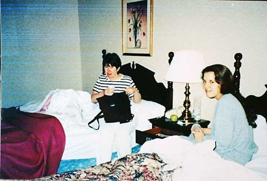 ** FILE ** In a photograph taken by Juli Sund that was released by Francis Carrington, Carole Sund, left, is shown with Silvina Pelosso, right, in their room at the Cedar Lodge in El Portal shortly before they were killed in February,1999. The photographs were released by family members before a jury began deliberations in the murder trial of Cary Stayner in San Jose, Calif., Thursday, Aug. 22, 2002. Stayner has pleaded innocent by reason of insanity to murdering Carole Sund, her 15-year-old daughter Juli and their 16-year-old friend Silvina Pelosso. (AP Photo/Juli Sund, Carrington Family) Photo: JULI SUND