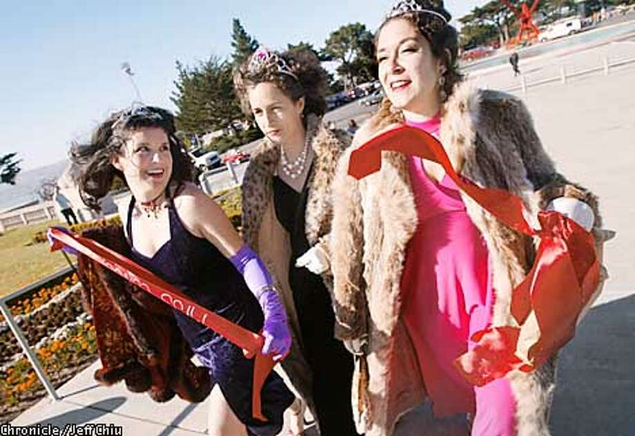 "From left: Volunteers Christina Harbridge aka ""Miss Conception,"" Frances Nkara, aka ""Miss Interpretation,"" and Michelle Maine aka ""Miss Demeanor,"" make their way to up the walkway in preparation for the Webby awards outside of the Legion of Honor in San Francisco on Tuesday evening. Photo by Jeff Chiu/The Chronicle Photo: Jeff Chiu"