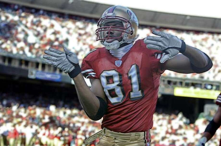 Terrell Owens does a celebritory dance after making the first touch down in the first quarter when The San Francisco 49ers play the Arizona Cardinals at Candlestick Point on 12/7/03 in San Francisco.Kat Wade / The Chronicle Photo caption skybox108_PH1070668800The ChronicleTerrell Owens does a celebritory dance after making the first touch down in the first quarter when The San Francisco 49ers play the Arizona Cardinals at Candlestick Point on 12-7-03 in San Francisco._Kat Wade - The Chronicle__MANDATORY CREDIT FOR PHOTOG AND SF CHRONICLE- -MAGS OUT Jeff Garcia threw four touchdown passes and ran for another two scores in the rout of the Cardinals at Candlestick Park. Photo caption skybox108_PH1070668800The ChronicleTerrell Owens does a celebritory dance after making the first touch down in the first quarter when The San Francisco 49ers play the Arizona Cardinals at Candlestick Point on 12-7-03 in San Francisco._Kat Wade - The Chronicle__MANDATORY CREDIT FOR PHOTOG AND SF CHRONICLE- -MAGS OUT Cedrick Wilson outruns Arizona's James Darling (51) on a 27-yard TD pass. Cedrick Wilson outruns Arizona's James Darling (51) on a 27-yard TD pass. Also ran 03/06/04 Photo: Kat Wade