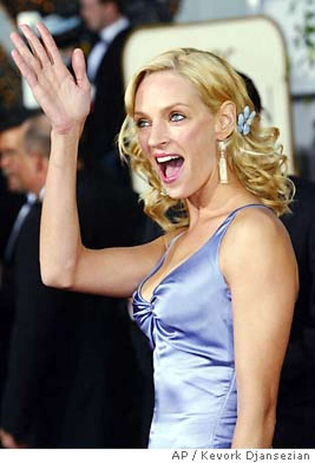 "Uma Thurman, nominated for best actress in a drama for her work in ""Kill Bill Vol. 1,"" arrives for the 61st Annual Golden Globe Awards on Sunday, Jan. 25, 2004, in Beverly Hills, Calif. (AP Photo/Kevork Djansezian) Photo: KEVORK DJANSEZIAN"