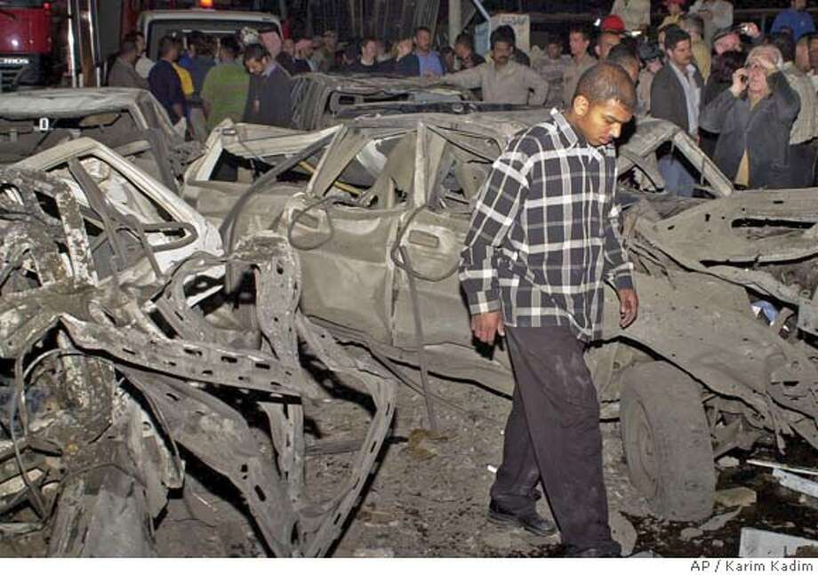 Rescue workers look for survivors after a huge car bomb destroyed a five-storey hotel in central Baghdad, Wednesday March 17, 2004, killing at least 27. (AP Photo/Karim Kadim) Photo: KARIM KADIM