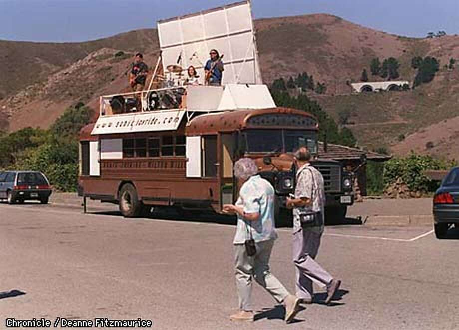Sonic Joyride, an unknown band touring the country in a bus that turns into their stage, sets up at Vista Point with Marin Headlands as a background. CHRONICLE PHOTO BY DEANNE FITZMAURICE