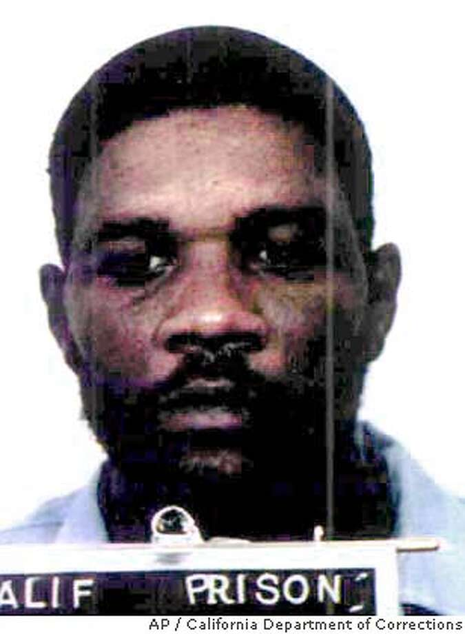 ** FILE ** Kevin Cooper is shown in an undated photo released by California Department of Corrections. Cooper, scheduled to die by lethal injection next month for the savage slayings of four after he escaped a Chino Hills prison in 1983, petitioned Gov. Arnold Schwarzenegger on Friday, Jan. 9, 2004, for new DNA testing that he says will demonstrate his innocence. (AP Photo/California Department of Corrections) BEST QUALITY