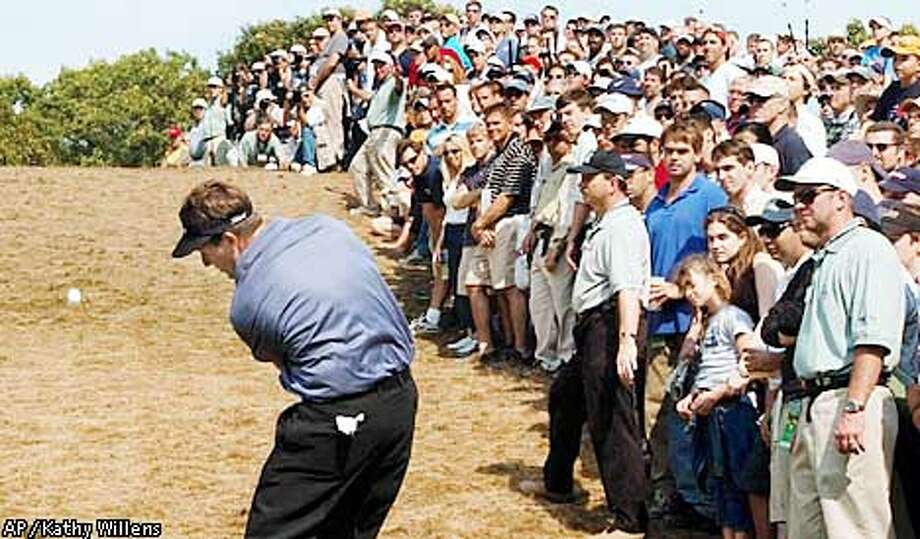 Phil Mickelson hits from under the fifth hole as the gallery looks on during the final round of the U.S. Open Golf Championship at the Black Course of Bethpage State Park in Farmingdale, N.Y., Sunday, June 16, 2002. (AP Photo/Kathy Willens) Photo: KATHY WILLENS