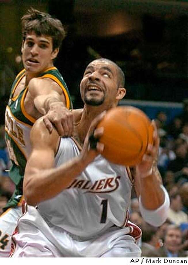 Cleveland Cavaliers' Carlos Boozer (1) is grabbed by Seattle SuperSonics' Richie Frahm in the first quarter Tuesday, Jan. 20, 2004, in Cleveland. (AP Photo/Mark Duncan) Photo: MARK DUNCAN