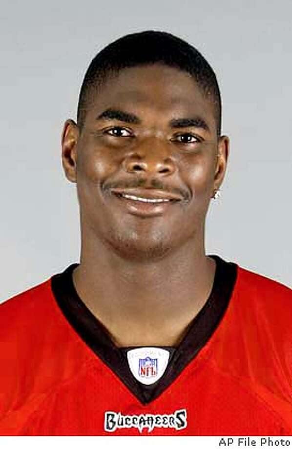 ** FILE ** Tampa Bay Buccaneers' Keyshawn Johnson, shown in this 2003 file photo,was deactivated for the rest of the season Tuesday, Nov. 18, 2003 a team source said. The eight-year pro, who is midway through a $56 million contract that included a $13 million signing bonus, has been unhappy with his role in coach Jon Gruden's offense during a disappointing 4-6 start for the defending champions. (AP Photo/file) Keyshawn Johnson Keyshawn Johnson CAT