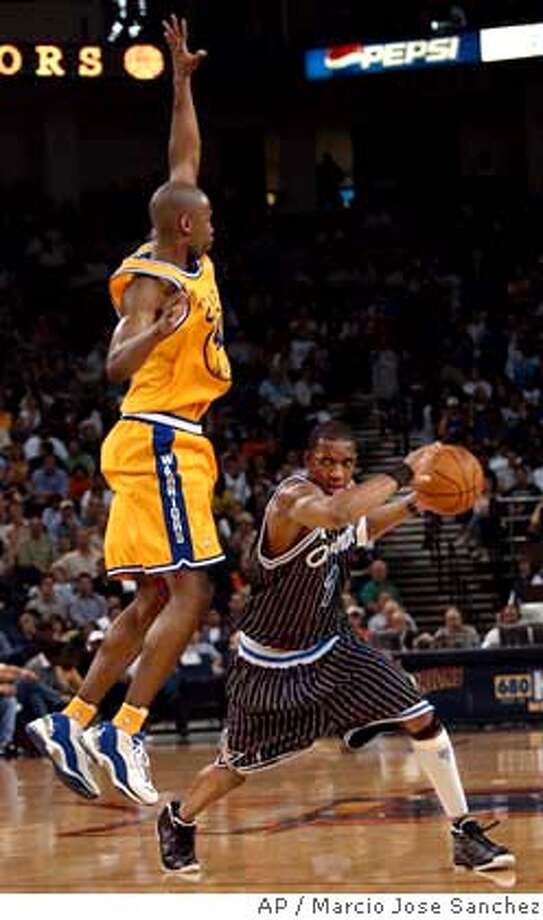 Orland Magic's Tracy McGrady, left, dribbles past Golden State Warriors' Calbert Cheaney in the second quarter on Wednesday, March 17, 2004, in Oakland, Calif. (AP Photo/Marcio Jose Sanchez) Photo: MARCIO JOSE SANCHEZ