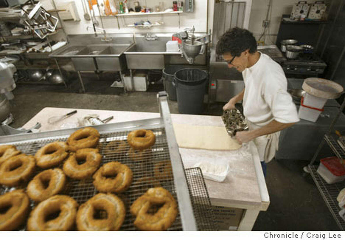 Mark Carter cuts out doughnuts by hand in the space he rents in a commercial bakery in Santa Rosa. Chronicle photo by Craig Lee