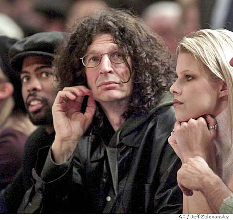 THIS IS A HANDOUT IMAGE. PLEASE VERIFY RIGHTS. CROWD09a-C-08DEC01-DD-HO  Comedian Chris Rock, left, radio personality Howard Stern and actress Beth Ostrosky, right, watch the New York Knicks play the Indiana Pacers at Madison Square Garden in New York, Saturday, Dec. 8, 2001. (AP Photo/Jeff Zelevansky) CAT DIGITAL CAMERA Photo: JEFF ZELEVANSKY