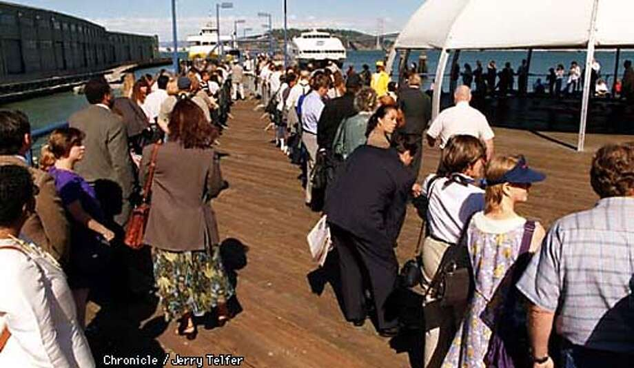 BART-FERRY/C/09SEP97/CD/JLT Long lines of commuters wait to board ferries at the SF Ferry Terminal. Line to the left is headed for Vallejo; the one to the right is going to Oakland. Late afternoon (3:30pm) lines went all the way from the dock to The Embarcadero, and wrapped around to end nearly a block away. PHOTO BY JERRY TELFER Photo: JERRY TELFER