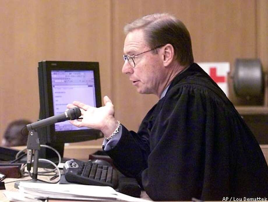 Superior Court Judge James Warren gestures while throwing out a second-degree murder conviction against Marjorie Knoller in San Francisco, Monday, June 17, 2002, in the 2001 dog mauling that killed neighbor Diane Whipple. But Warren let stand involuntary manslaughter convictions against Knoller and her husband, Robert Noel. (AP Photo/Lou Dematteis, Pool) Photo: LOU DEMATTEIS