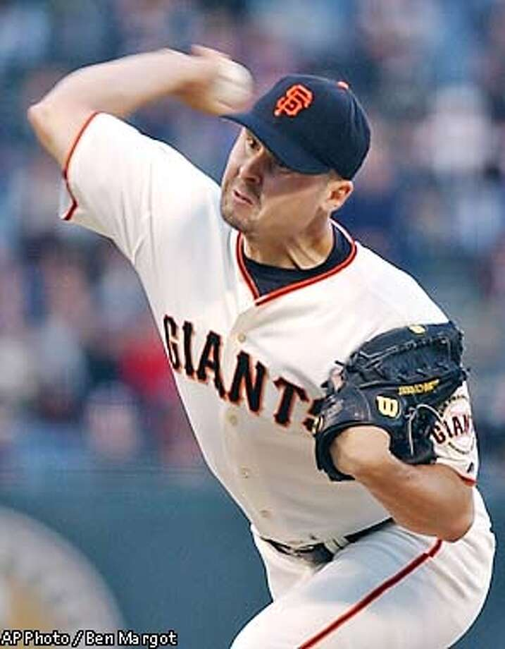 San Francisco Giants' Jason Schmidt winds up against the New York Mets in the first inning Tuesday, Aug. 20, 2002, at Pacific Bell Park in San Francisco. (AP Photo/Ben Margot) Photo: BEN MARGOT