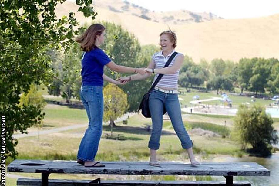 Hilarye Gibson age 17 and Kristen Nielsen age 18 both from Antioch dance atop a picnic table at Conta Loma Park in Antioch. the girls along with a dozen friends visited the park for the last time prior to returning to school next week. Gibson will return to Deer Valley High in Antioch and Nielsen will attend Sacramento State.  By LANCE IVERSEN/SAN FRANCISCO CHRONICLE Photo: LANCE IVERSEN