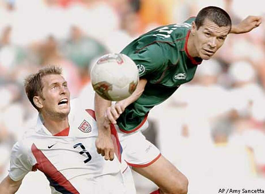 ** RETRANSMISSION FOR ALTERNATE CROP ** Mexico's Jared Borgetti, right, goes for the ball against USA's Gregg Berhalter during action in their 2002 World Cup second round playoff soccer match at the Jeonju World Cup Stadium at Jeonju, South Korea, Monday, June 17, 2002. (AP Photo/Amy Sancetta) Photo: AMY SANCETTA