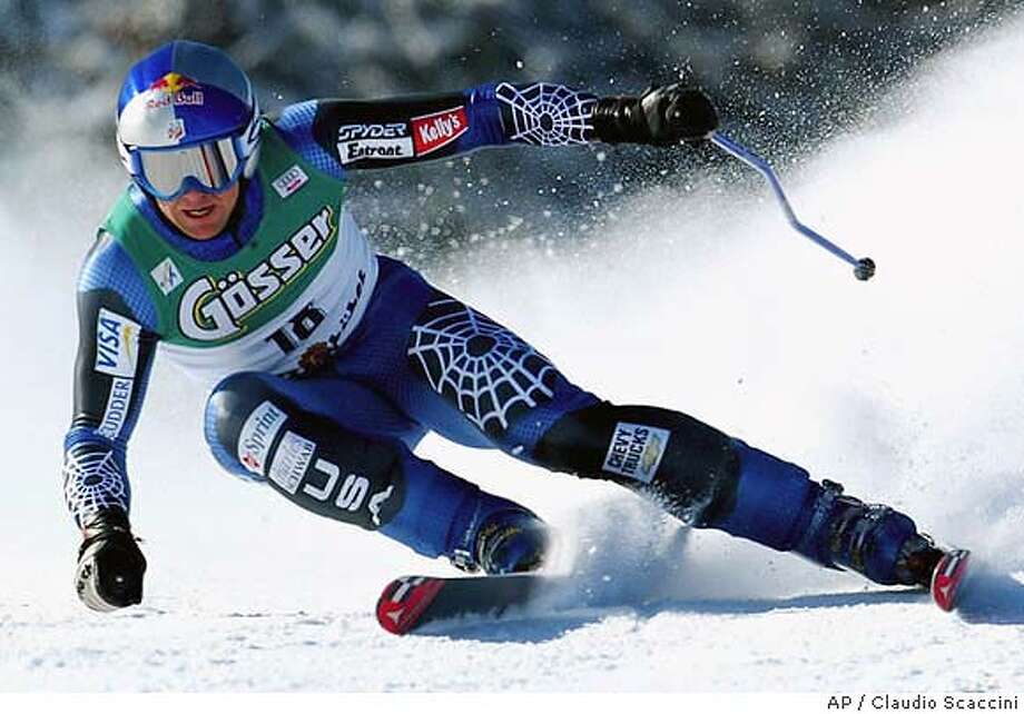 Daron Rahlves from the United States speeds down the Hahnenkamm course in Kitzbuehel, Austria, on Friday, Jan. 23, 2004, to win the men's ski World Cup super G race. (AP Photo/Claudio Scaccini) Photo: CLAUDIO SCACCINI