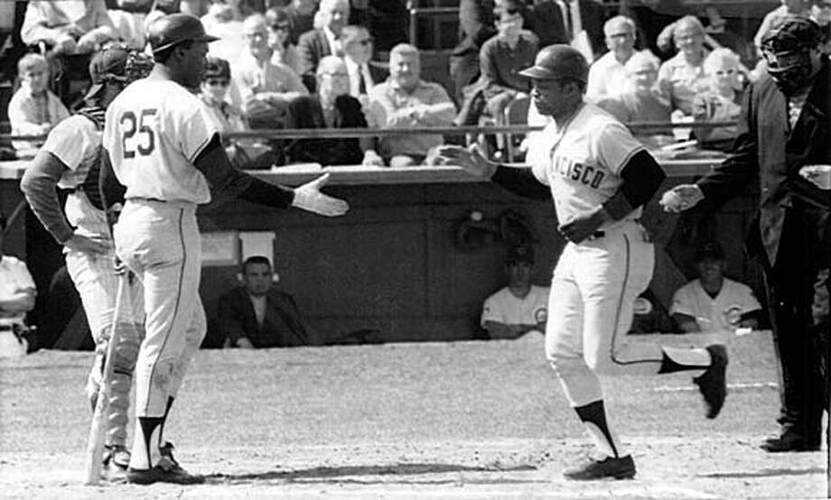 Willie Mays, SF Giants is greeted at home plate by Bobby Bonds after his 1st homerun of the year against the Chicago Cubs on March 6, 1970.