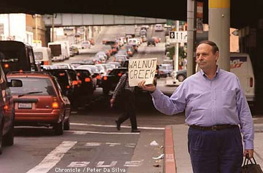 Marvin Suchman of Walnut Creek who hitched hiked in to San Francisco in the morning tried to get home in the same manner along First Street by the TransBay Treminal during the evening commute. Chronicle Staff Photo By: Peter DaSilva Photo: Peter DaSilva