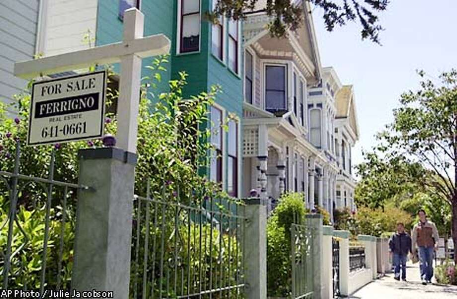 "A ""For Sale"" sign adorns the front yard of a Victorian-style home along Guerrero Street in San Francisco, Monday, June 24, 2002. California's housing market remained red hot in May as in both the San Francisco Bay area and Southern California hit new highs, with a mid-priced home in the Bay Area selling at $413,000 and a mid-priced home in Southern California going at $264,000. (AP Photo/Julie Jacobson) Photo: JULIE JACOBSON"