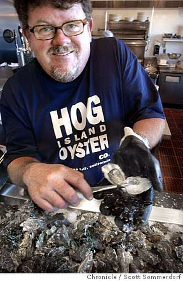 "Mike Watchorn demontrates the proper form in shucking an oyster. This week's ""What's New"" is about different restaurants that offer cooking classes. Hog Island Oyster Co.'s oyster bar in the Ferry Building is offering classes on shucking and cooking oysters, partly taught by co-owner of Hog Island Oyster Co. and manager of the bar, Mike Watchorn. Shot on 3/12/04 in San Francisco.  Photo by SCOTT SOMMERDORF for The Chronicle Photo: SCOTT SOMMERDORF"
