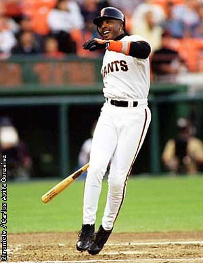 Giants left fielder Barry Bonds, (25), smiles in frustration after fouling in the bottom of the first inning in the Giants game against the St. Louis Cardinals in 3Com Park on Tuesday night, September 9, 1997. (CHRONICLE PHOTO BY CARLOS AVILA GONZALEZ) Photo: CARLOS AVILA GONZALEZ