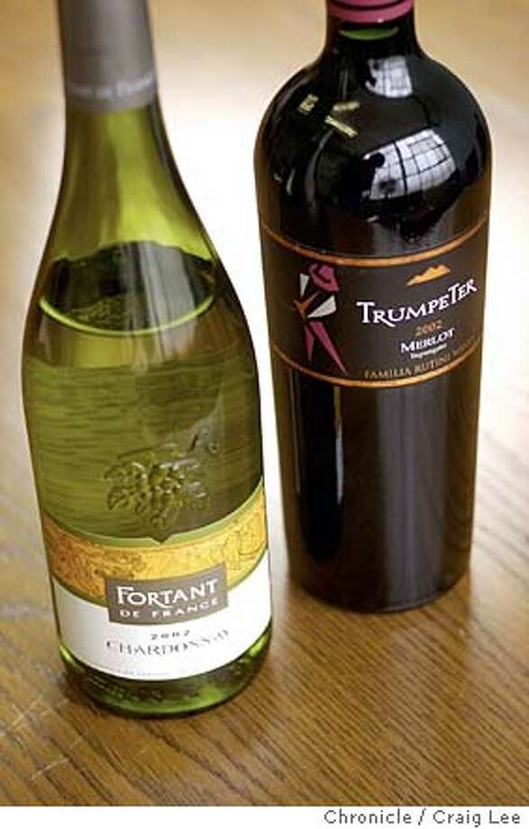 Bottles of wine for the Bargain Wines column. Photo of 2002 Fortant de France Chardonnay (left) and 2002 Trumpeter Merlot (right).  Event on 1/16/04 in San Francisco.  CRAIG LEE / The Chronicle Photo: CRAIG LEE