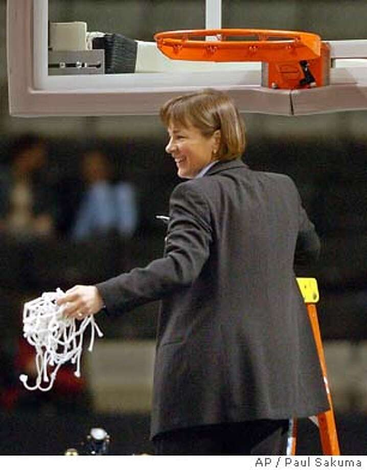 Stanford head coach Tara VanDerveer smiles after cutting down the net after Stanford defeated Arizona 51-46 in the finals of the Pac-10 tournament in San Jose, Calif., Monday, March 8, 2004. (AP Photo/Paul Sakuma) ProductName	Chronicle Tara VanDerveer has coached Stanford to 599 wins and two NCAA titles but hasn't reached the Final Four since 1997. Photo: PAUL SAKUMA