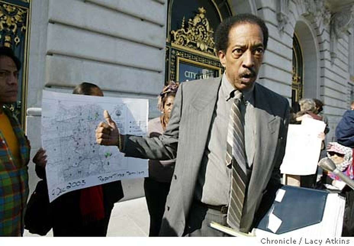 Maurice Campbell , points to the neigborhood maps as he talks about the neigborhood that were affected by the fraud in the mayoral election, as he outisde the San Francisco City HAll, Thursday Jan.22,2004. A group calling itself the People of Color Caucus holds a press conference to call for widening the city attorneys investigation of alleged voter fraud, at City Hall in San Francisco, thurs, Jan.22, 2004. Lacy Atkins / The Chronicle