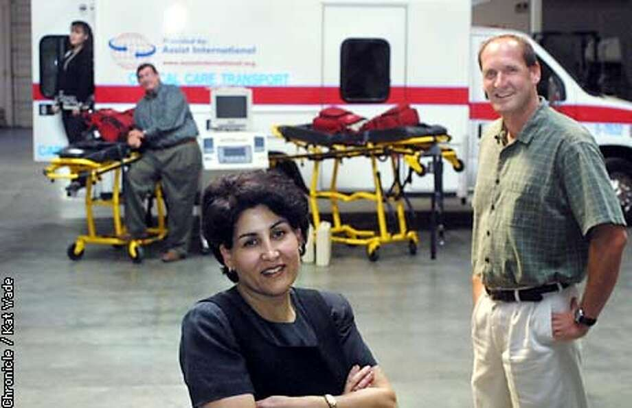 (l to r) Heather, operations manger and John Harwood of Meridian Worldwide Transoportation , Rona Popal of the Afghan Coalition and Tim Reynolds, executive director of Assist International pose in the Fremont wearhouse where the donated ambulance and other medical equipment that have been donated by companies and firehouses to be shiped to Afghanistan. SAN FRANCISCO CHRONICLE PHOTO BY KAT WADE Photo: KAT WADE