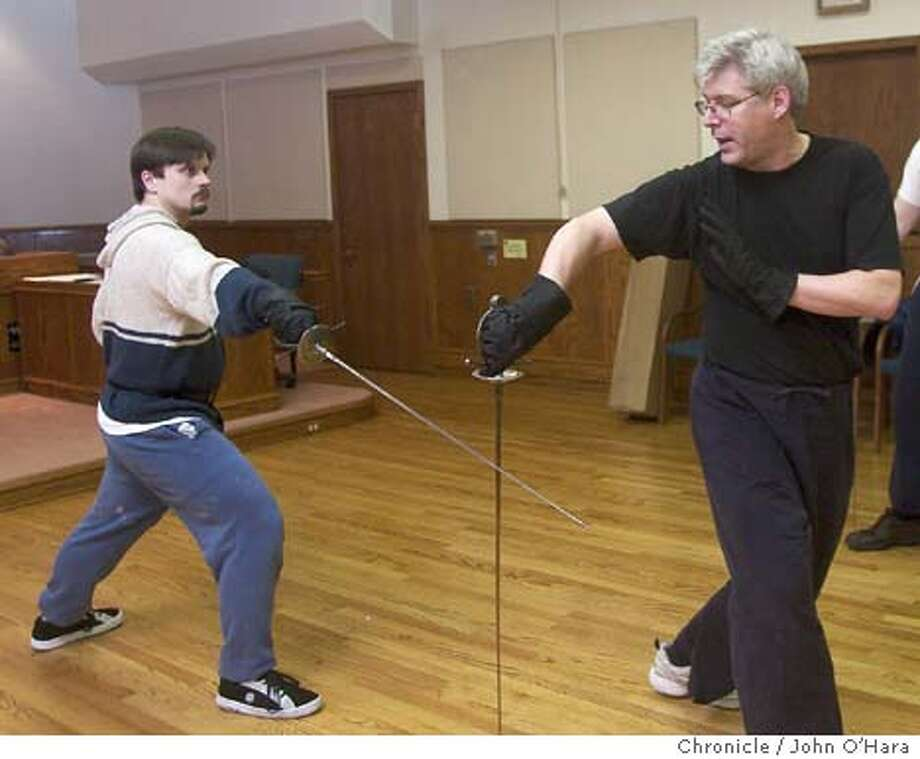 Village Theater, 233 front St. danville,CA  REHERSAL, THREE MUSKETEERES  Eddie Peabody and Instructor Steve Hill , practice the steps of the sword fight.  Steven Hill is a play director, fight director & lighting designer from Berkeley and currently working on The Three Musketeers (runs Jan 23 - Feb 14 @ Village Theatre in Danville). Focus on his fight directing - he�s choreographing 28 fight sequences for the show. Photo: JOHN O'HARA