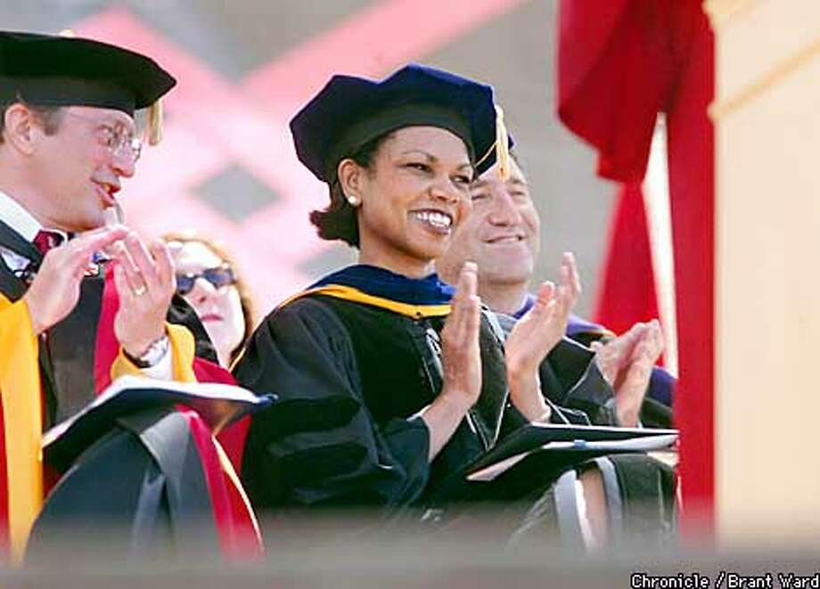 Stanford commencement speaker Condoleezza Rice applauded along with Provost John Etchemendy (left). Rice was provost before becoming national security adviser. Chronicle photo by Brant Ward