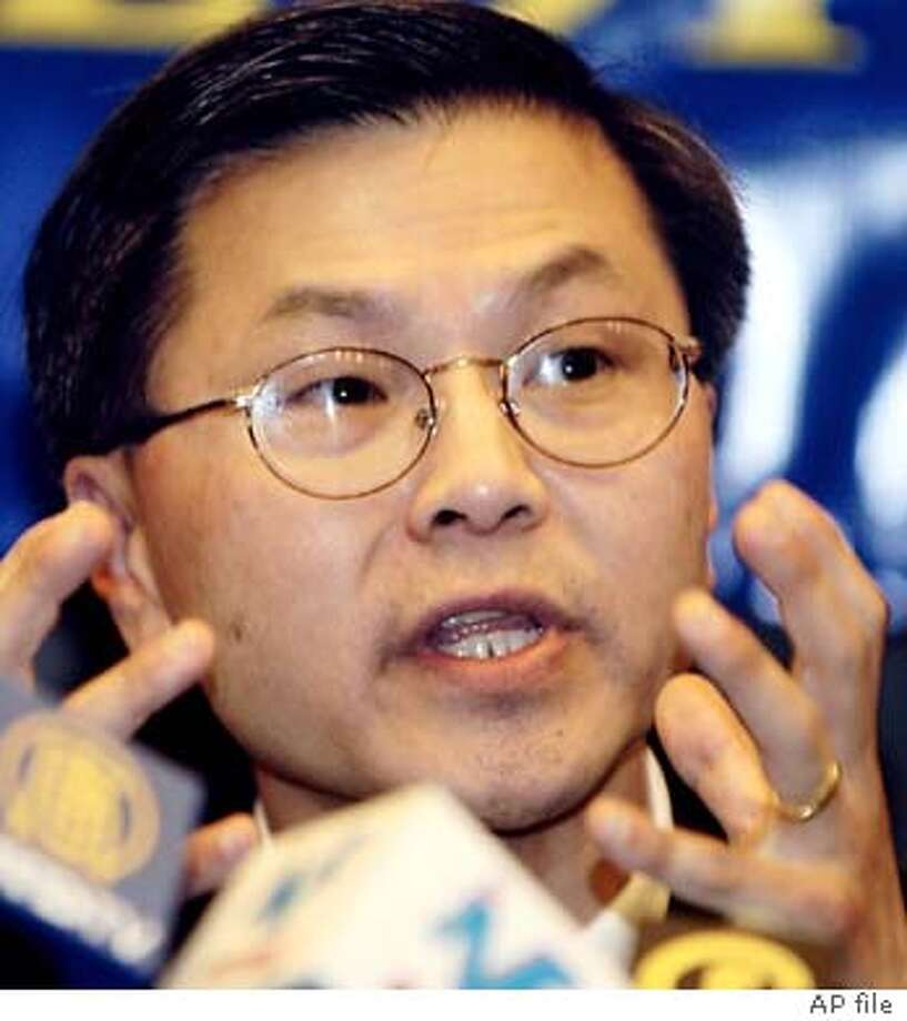 Dr. David Ho, one of the researchers who pioneered the drug cocktail treatment for AIDS patients, gestures during a press conference in Hong Kong Sunday, May 11, 2003. Ho said the SARS virus apparently attacks people's cells in a manner similar to the AIDS virus, which may offer clues for finding the best drugs to treat the newly discovered disease. (AP Photo/Vincent Yu) Photo: VINCENT YU