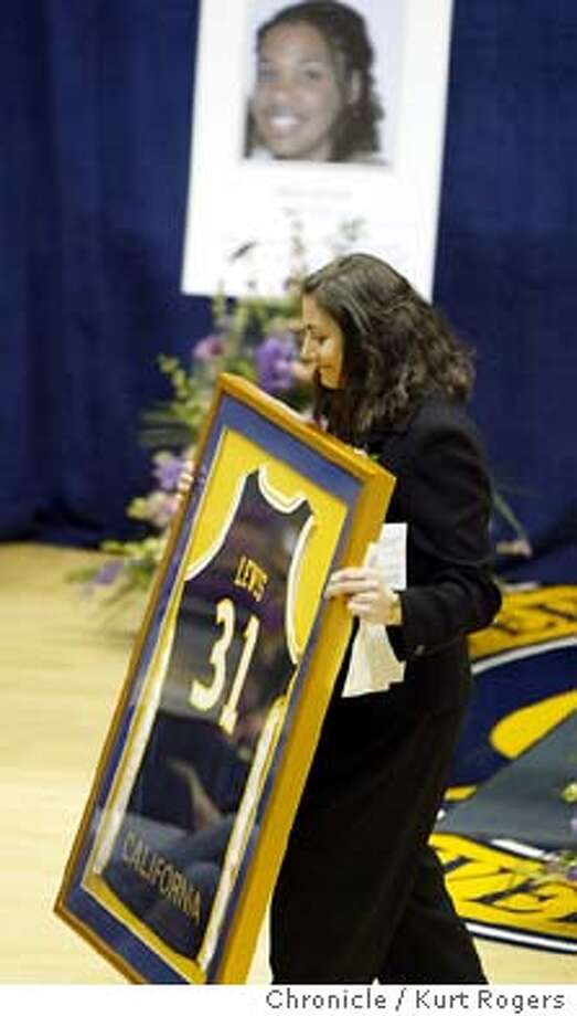 Head Coach Caren Horstmeyer Presented the Lewis Family the Framed jersey of Alisa Lewis during a memorial service at Cal in the Haas arena.  memorial service for cal basketball player Alisa lewis at haas pavilion on cal campus. Event on 1/22/04 in Berkeley. KURT ROGERS / The Chronicle Photo: KURT ROGERS