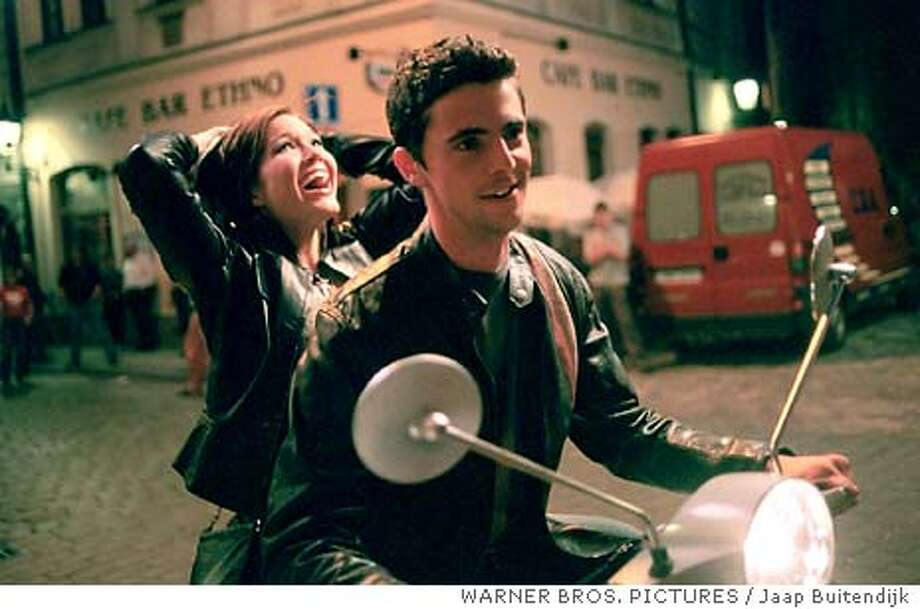 "Mandy Moore and Matthew Goode star in Alcon Entertainments young adult romantic comedy ""Chasing Liberty."" (WARNER BROS. PICTURES / Jaap Buitendijk) Mandy Moore escapes with Matthew Goode to freedom -- or so she thinks -- in &quo;Chasing Liberty.&quo; Photo: JAAP BUITENDIJK"