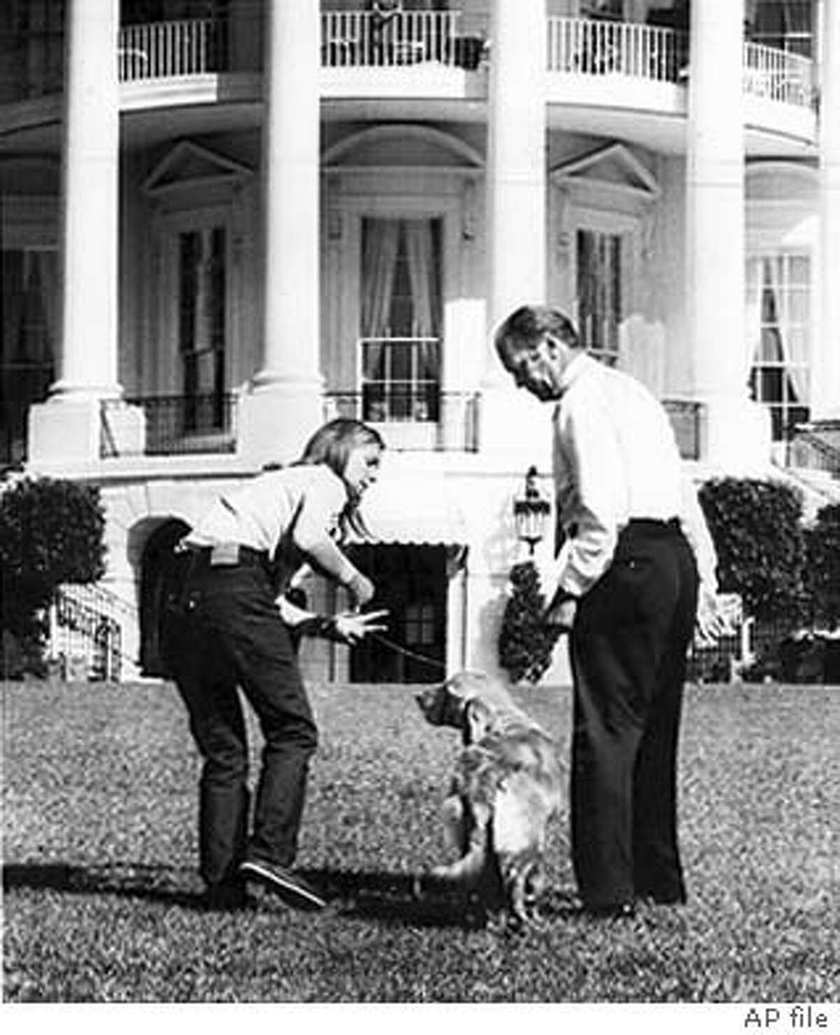PRESIDENT GERALD FORD AND DAUGHTER SUSAN ROMP WITH