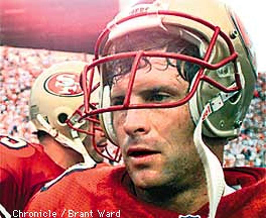 Steve Young walked off the field dazed after losing to Tampa Bay. By Brant Ward/Chronicle