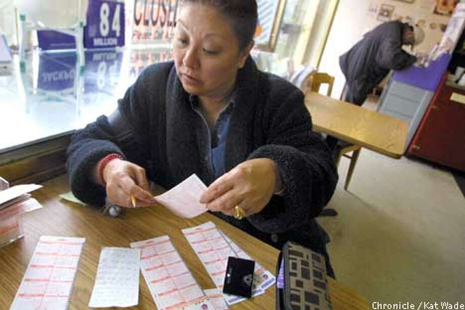Tomiko Russell, of San Francisco, carefully checks the list of numbers her mother gave her to buy a dozen lottery tickets in hopes of winning the $84 million dollar Lottery Jackpot that will be up for grabs Wednesday. In the background, Genrich (CQ) Sait fills out his tickets at The Sugar Bowl a small shop in the Richmond District that has sold several millionaire winning tickets in the past. SAN FRANCISCO CHRONICLE PHOTO BY KAT WADE Photo: KAT WADE