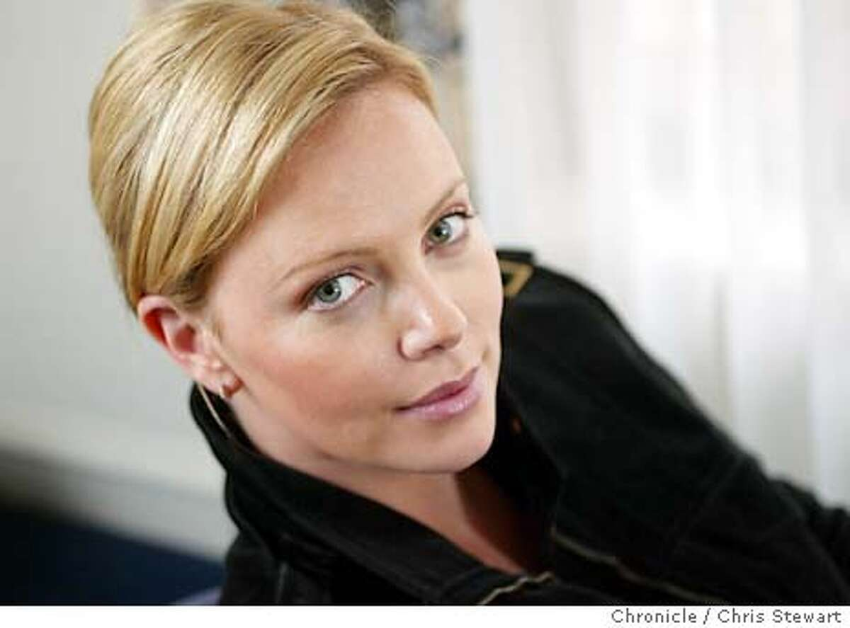 theron02001_cs.jpg Event on 12/22/03 in San Francisco. Charlize Theron is in town to talk about